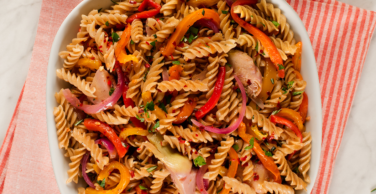 Fusilli pepperonata with roasted sweet peppers, artichokes and chilies